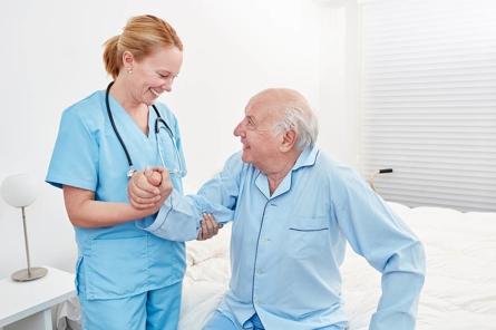 bigstock-Female-carer-or-nurse-helps-a-247971070