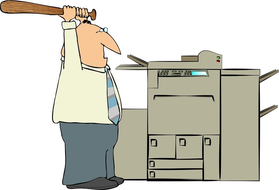 bigstock-Man-Beating-A-Copy-Machine-2011848